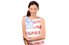Attractive girl with USA flag on her blouse. Stock Photos