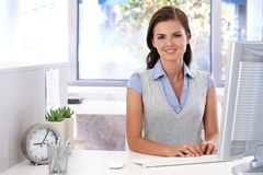 Attractive girl using computer in office stock photo