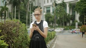 Attractive girl using mobile phone to find an address with a gps navigator