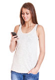 Attractive girl using smart phone Royalty Free Stock Images
