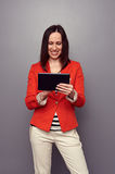 Girl using tablet pc and smiling Royalty Free Stock Image