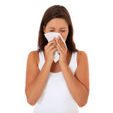 Attractive girl using tissue Royalty Free Stock Images