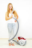 Attractive girl with vacuum cleaner Stock Images