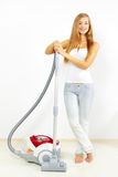 Attractive girl with vacuum cleaner Royalty Free Stock Photos