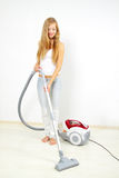 Attractive girl with vacuum cleaner Royalty Free Stock Photography