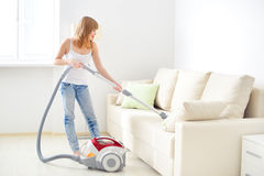 Girl cleaning sofa Royalty Free Stock Photo
