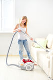 Young girl cleaning sofa Royalty Free Stock Photos