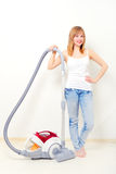 Attractive girl with vacuum cleaner Royalty Free Stock Images
