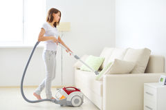 Attractive girl with vacuum cleaner Stock Photo
