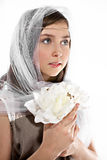 Attractive girl with veil and flowers Stock Photo