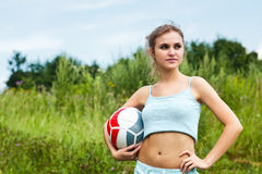 Attractive girl with volleyball ball Royalty Free Stock Photo