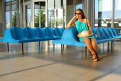 Attractive girl waiting somebody Royalty Free Stock Image