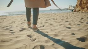 Attractive girl walks near shore line in small mediterranean town stock video footage