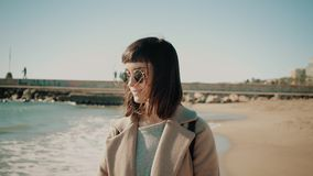 Attractive girl walks near shore line in small mediterranean town stock footage