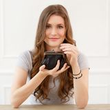 Attractive girl with wallet Royalty Free Stock Photos