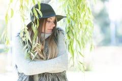 Attractive girl warm herself Stock Photo