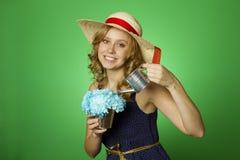 Attractive girl watering flowers Stock Image