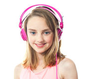 Attractive girl wearing pink headphones Stock Images