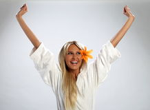 Attractive girl in a white bathrobe feeling happy Royalty Free Stock Photography