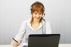 Attractive girl in a white blouse with a laptop Royalty Free Stock Photos