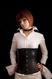 Attractive girl in white blouse and leather corset Royalty Free Stock Images