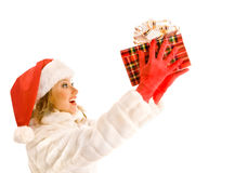 Attractive Girl in a White Fur Coat and Santa Claus Hat  with Ch Royalty Free Stock Photography
