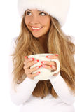 Attractive girl in white fur hat with white mug Stock Photos