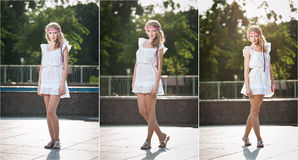 Attractive girl in white short dress sitting near the fountain in the summer hottest day Stock Photography