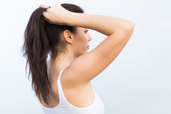 Attractive girl in white tank top Royalty Free Stock Photography