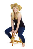 Attractive girl in the wicker hat Royalty Free Stock Image
