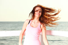 Attractive girl with wind in her hair outdoor Royalty Free Stock Images