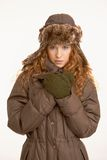 Attractive girl in winter clothes. Attractive girl dressed up in coat, scarf, gloves and fur- hat Stock Images