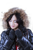 Attractive girl in winter clothes with fur hood Stock Photos