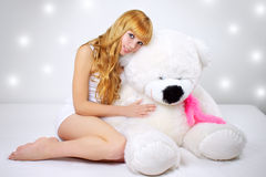 Attractive Girl With A Teddy Bear On Gray Stock Image