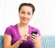Attractive Girl With Mobile Phone Royalty Free Stock Photos