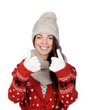Attractive girl with wool hat and scarf saying Ok Stock Image