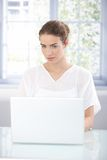 Attractive girl working at home using laptop Royalty Free Stock Photos