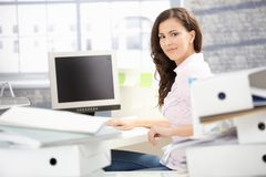 Attractive Girl Working In Bright Office Smiling Royalty Free Stock Images