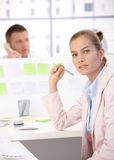 Attractive girl working in office Royalty Free Stock Photos