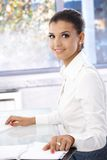 Attractive girl working in office smiling Royalty Free Stock Photo