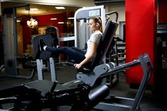 Attractive girl working our on a huge training simulator royalty free stock images
