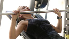Attractive girl works with Barbell in modern gym stock video footage