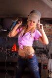 Attractive girl in workshop Stock Image