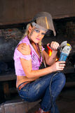Attractive girl in workshop with instrument Royalty Free Stock Photos