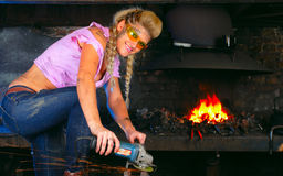 Attractive girl in workshop with instrument Royalty Free Stock Images