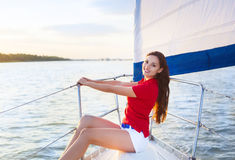 Attractive girl on a yacht at summer day Stock Photo