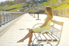 Attractive girl in a yellow dress Stock Photo