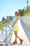 Attractive girl in a yellow dress Stock Photos