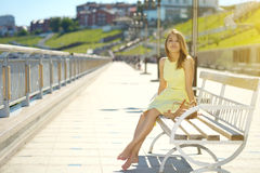 Attractive girl in a yellow dress Royalty Free Stock Photo