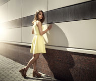 Attractive girl in a yellow dress Stock Image